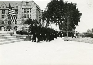 Bapst Library exterior: dedication with Jesuits